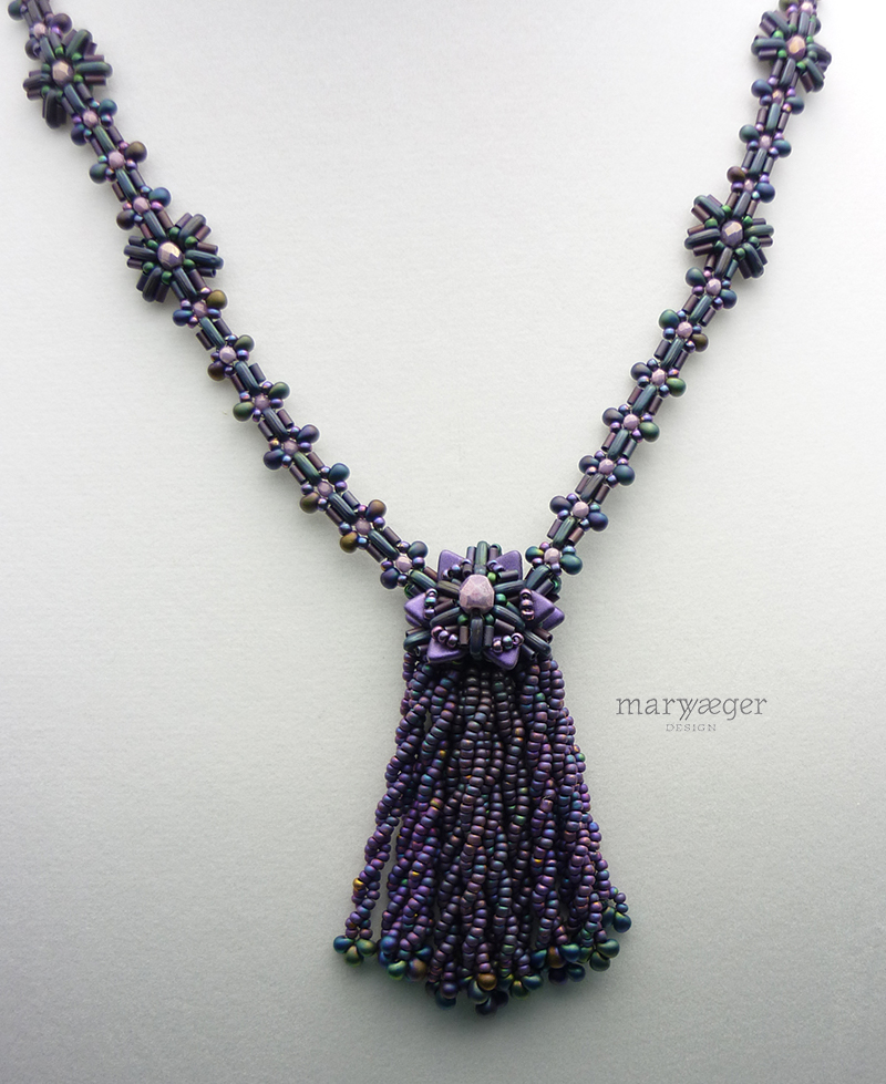 Twisted beaded tassel with magatama drops, beaded beadcap and chain
